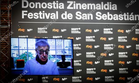 Woody Allen (on screen, up) takes part in a press conference during the presentation of the film 'Rifkin's Festival', his latest movie filmed in San Sebastian, as part of the 68th edition of the San Sebastian International Film Festival (SSIFF), in San Sebastian, Spain, 18 September 2020. The film festival will run from 18 to 26 September 2020 under safety measures like obligatory face mask use and red carpets without public due to the Covid-19 coronavirus pandemic. Organizers have also reduced the number of film screenings as well as the seating capacity in cinemas.