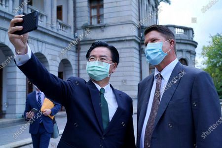 Stock Photo of In this photo released by the Taiwan Ministry of Foreign Affairs, Taiwan's Foreign Minister Joseph Wu pose for a selfie with U.S. Under Secretary of State Keith Krach, right, during a meeting in Taipei, Taiwan, . China's military sent 18 planes including fighter jets over the Taiwan Strait in an unusually large show of force Monday as a U.S. envoy held a day of closed-door meetings on the self-governing island claimed by China