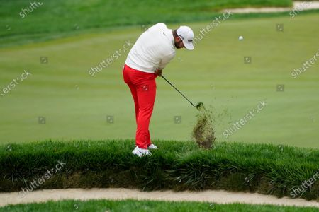 Stock Photo of Matthew Wolf plays a shot from the fringe of a bunker on the 15th hole during the second round of the US Open Golf Championship, in Mamaroneck, N.Y