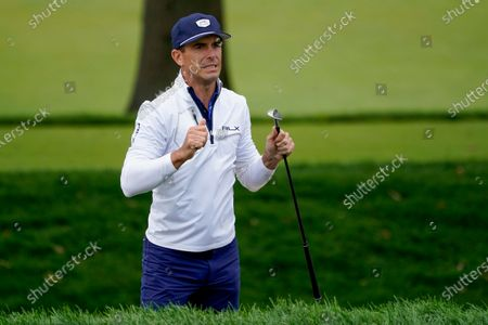 Billy Horschel, of the United States, reacts after missing a shot for birdie on the 17th green during the second round of the US Open Golf Championship, in Mamaroneck, N.Y