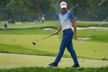 Danny Willett, of England, checks the break on the second green during the second round of the US Open Golf Championship, in Mamaroneck, N.Y