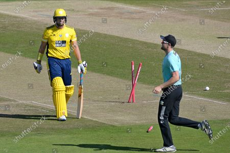 wicket - George Munsey of Hampshire walks off afer being bowled by Reece Topley off the first ball of the Vitality T20 Blast South Group match between Hampshire County Cricket Club and Surrey County Cricket Club at the Ageas Bowl, Southampton