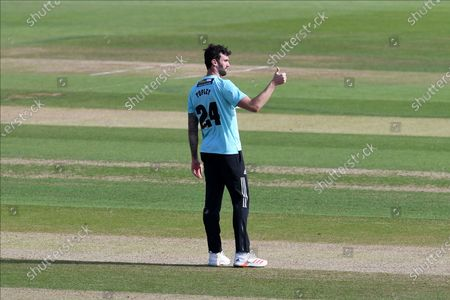 Reece Topley of Surrey gives a thumbs up after Liam Plunkett caught Ian Holland of Hampshire during the Vitality T20 Blast South Group match between Hampshire County Cricket Club and Surrey County Cricket Club at the Ageas Bowl, Southampton