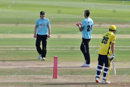 Reece Topley of Surrey applauds after Rory Burns had taken a diving catch during the Vitality T20 Blast South Group match between Hampshire County Cricket Club and Surrey County Cricket Club at the Ageas Bowl, Southampton