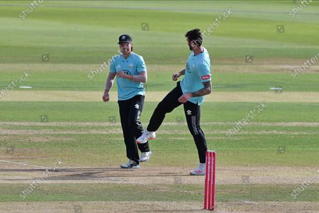 Rory Burns and Reece Topley of Surrey celebrate a wicket during the Vitality T20 Blast South Group match between Hampshire County Cricket Club and Surrey County Cricket Club at the Ageas Bowl, Southampton