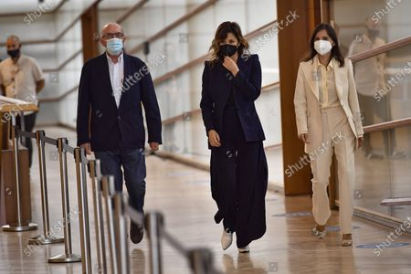 Actresses Gina Gershon of US, center, Elena Anaya of Spain, arrive with film producer Jaume Roures during a photo call to promote Woody Allen's film Rifkin's Festival during the 68th San Sebastian Film Festival, in San Sebastian, northern Spain