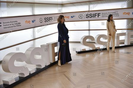 Actresses Gina Gershon of US, left, and Elena Anaya of Spain, pose during a photo call to promote Woody Allen's film Rifkin's Festival during the 68th San Sebastian Film Festival, in San Sebastian, northern Spain