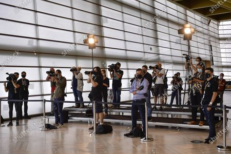 Stock Photo of Journalists obeying social distancing rules and wearing mask face protection to prevent the spread of the coronavirus, stand on their positions during a photo call for Woody Allen's film Rifkin's Festival during the 68th San Sebastian Film Festival, in San Sebastian, northern Spain