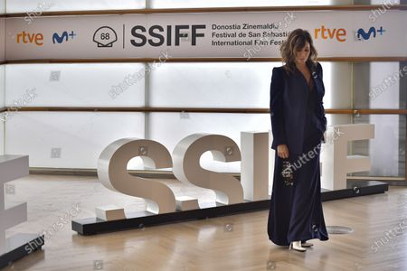 Actress Gina Gershon holds a mask face while posing during a photo call to promote Woody Allen's film Rifkin's Festival during the 68th San Sebastian Film Festival, in San Sebastian, northern Spain