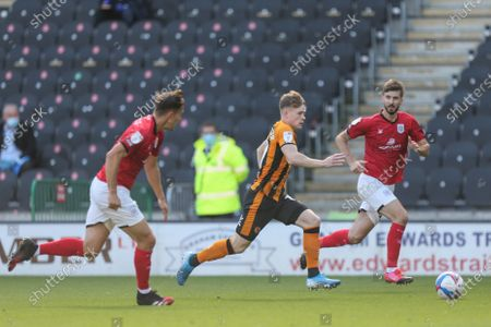 Keane Lewis-Potter (19) of Hull City gets through the defence
