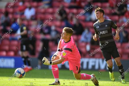 Stock Photo of Josef Bursik (1) of Doncaster FC rolls the ball out