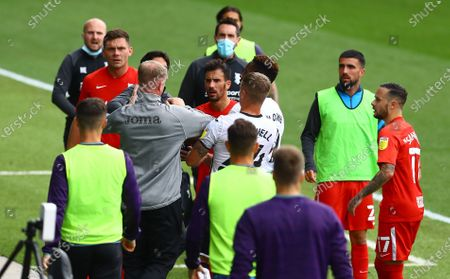 Swansea City coach Alan Tate gets involved in an incident with Jon Toral of Birmingham City after the half time whistle