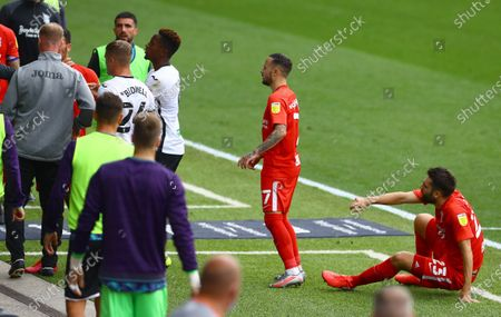 Jon Toral of Birmingham City on the floor after an incident with Swansea City coach Alan Tate after the half time whistle