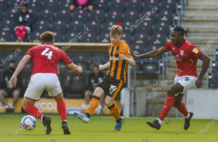 Keane Lewis-Potter of Hull City watched by Omar Beckles of Crewe Alexandra