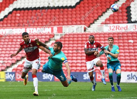 Ashley Fletcher of Middlesbrough beats Steve Cook of Bournemouth to get a header at goal