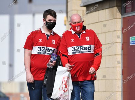 Two Middlesbrough fans who are part of the lucky 1,000 make their way to the ground