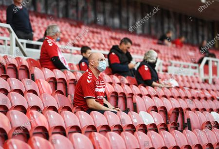 A Middlesbrough supporter, on the day that the EFL are piloting a scheme to introduce supporters back in during the Coronavirus pandemic. With an initial 1,000 fans being allowed in to the game to watch them play Bournemouth.