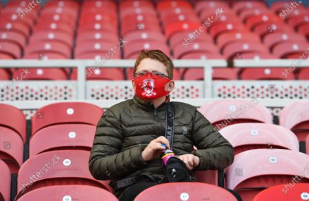 A young Middlesbrough supporter, on the day that the EFL are piloting a scheme to introduce supporters back in during the Coronavirus pandemic. With an initial 1,000 fans being allowed in to the game to watch them play Bournemouth.