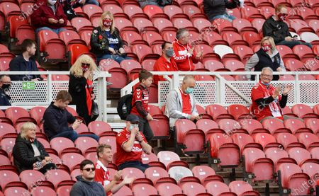 Middlesbrough supporters, on the day that the EFL are piloting a scheme to introduce supporters back in during the Coronavirus pandemic. With an initial 1,000 fans being allowed in to the game to watch them play Bournemouth.