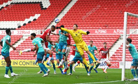 Asmir Begovic goalkeeper for Bournemouth punches the ball away ahead of Ashley Fletcher of Middlesbrough