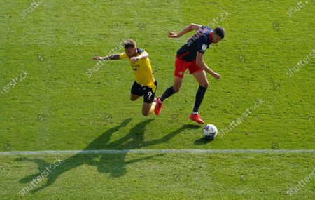 Tom Flanangan of Sunderland out muscles Matty Taylor of Oxford United