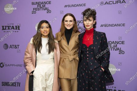 "Actors, from left, Gina Rodriguez and Evan Rachel Wood pose with writer-director Miranda July at the premiere of ""Kajillionaire"" during the 2020 Sundance Film Festival in Park City, Utah on . The film is about a family of grifters in Los Angeles"