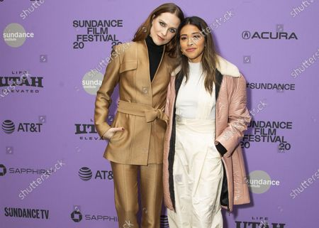 "Actresses Evan Rachel Wood, left, and Gina Rodriguez attend the premiere of ""Kajillionaire"" during the 2020 Sundance Film Festival in Park City, Utah on . The film is about a family of grifters in Los Angeles"