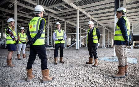 Britain's Prime Minister Boris Johnson talks with scientists as he visits the construction site of the new vaccines Manufacturing and Innovation Centre (VMIC), currently under construction on the Harwell science and innovations campus near Didcot, England
