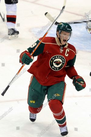 Minnesota Wild's Mikko Koivu, of Finland, celebrates his short-handed goal against the New Jersey Devils during the second period of an NHL hockey game in St. Paul, Minn. Koivu's extraordinary career with the Minnesota Wild is over. General manager Bill Guerin said, the team will not resign the 37-year-old Finn, whose contract is expiring