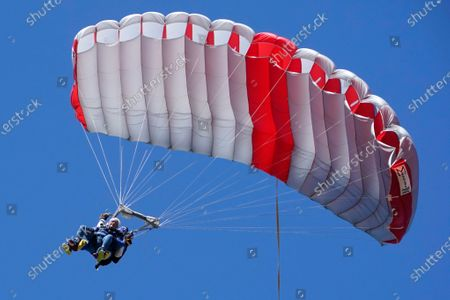 Dale Crafts, Republican candidate for Maine's 2nd Congressional District, parachutes in tandem with instructor Owen Ross, in Millinocket, Maine. Crafts was struck by a car while riding a motorcycle at age 25, leaving him paralyzed from the waist down