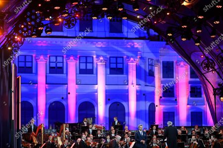 Stock Image of Russian conductor Valery Gergiev (R) and German tenor Jonas Kaufmann (L) perform during the 'Summer Night Concert' (Sommernachtskonzert) at the Schoenbrunn Palace gardens, in Vienna, Austria, 18 September 2020. Due to the COVID-19 coronavirus pandemic and the measures of the Austrian government to contain the spread of the virus, only 1,250 guests, instead of up to 100,000 people, were allowed to attend the annual open-air concert with free admission at the palace and its baroque gardens, which are a UNESCO world cultural heritage site.