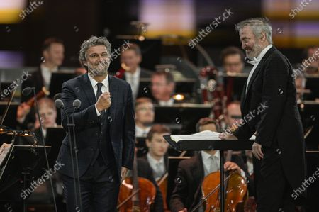 Stock Photo of Russian conductor Valery Gergiev (R) and German tenor Jonas Kaufmann (L) perform during the 'Summer Night Concert' (Sommernachtskonzert) at the Schoenbrunn Palace gardens, in Vienna, Austria, 18 September 2020. Due to the COVID-19 coronavirus pandemic and the measures of the Austrian government to contain the spread of the virus, only 1,250 guests, instead of up to 100,000 people, were allowed to attend the annual open-air concert with free admission at the palace and its baroque gardens, which are a UNESCO world cultural heritage site.
