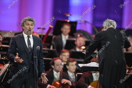 Russian conductor Valery Gergiev (R) and German tenor Jonas Kaufmann (L) perform during the 'Summer Night Concert' (Sommernachtskonzert) at the Schoenbrunn Palace gardens, in Vienna, Austria, 18 September 2020. Due to the COVID-19 coronavirus pandemic and the measures of the Austrian government to contain the spread of the virus, only 1,250 guests, instead of up to 100,000 people, were allowed to attend the annual open-air concert with free admission at the palace and its baroque gardens, which are a UNESCO world cultural heritage site.