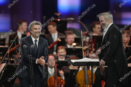 Stock Picture of Russian conductor Valery Gergiev (R) and German tenor Jonas Kaufmann (L) perform during the 'Summer Night Concert' (Sommernachtskonzert) at the Schoenbrunn Palace gardens, in Vienna, Austria, 18 September 2020. Due to the COVID-19 coronavirus pandemic and the measures of the Austrian government to contain the spread of the virus, only 1,250 guests, instead of up to 100,000 people, were allowed to attend the annual open-air concert with free admission at the palace and its baroque gardens, which are a UNESCO world cultural heritage site.