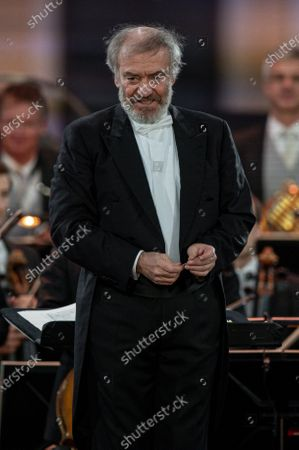 Russian conductor Valery Gergiev leads the Vienna Philharmonic Orchestra as they performs on stage during the 'Summer Night Concert' (Sommernachtskonzert) at the Schoenbrunn Palace gardens, in Vienna, Austria, 18 September 2020. Due to the COVID-19 coronavirus pandemic and the measures of the Austrian government to contain the spread of the virus, only 1,250 guests, instead of up to 100,000 people, were allowed to attend the annual open-air concert with free admission at the palace and its baroque gardens, which are a UNESCO world cultural heritage site.