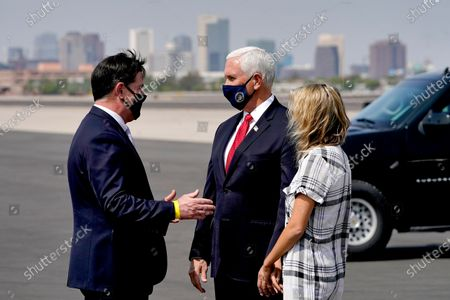 Vice President Mike Pence, center, and his daughter Charlotte Pence Bond, greet Arizona Gov. Doug Ducey after arriving at Sky Harbor International Airport, in Phoenix