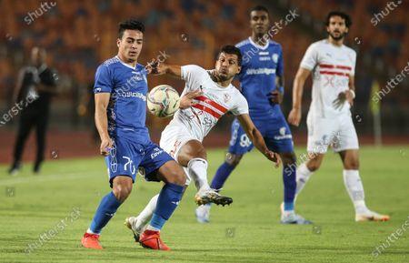 Zamalek player Tarek  Hamed (C) in action against Aswan player (L) Mohamed Ismail during the Egyptian Premier League soccer match between Zamalek and Aswan, in Cairo, Egypt, 18 September 2020.