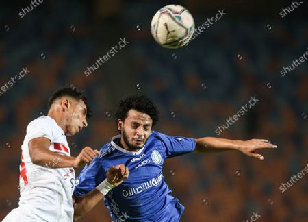Zamalek player TOsama Faisal (L) in action against Aswan player Mohamed Morsi (R) during the Egyptian Premier League soccer match between Zamalek and Aswan, in Cairo, Egypt, 18 September 2020.
