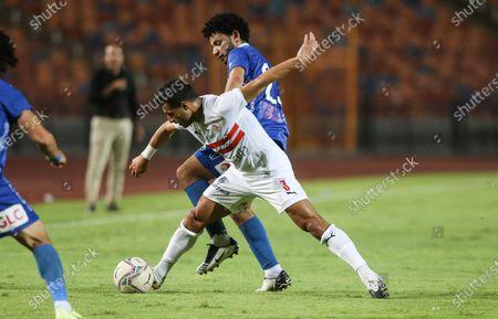 Zamalek player Tarek  Hamed (l) in action against Aswan player Mohamed Morsi (back) during the Egyptian Premier League soccer match between Zamalek and Aswan, in Cairo, Egypt, 18 September 2020.