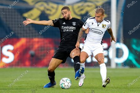 Famalicao's Guga (R) in action against Benifca's Adel Taarabt during their Portuguese First League soccer match, held at Municipal Stadium, in Famalicao, north of Portugal, 18 September 2020.