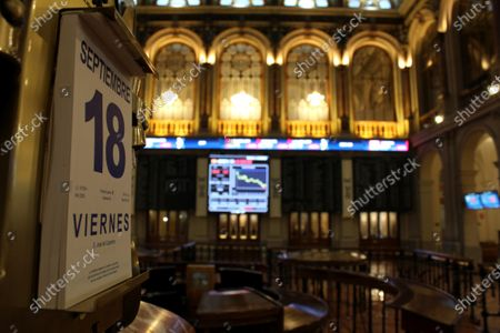 A calendar marks the date as several screens show the activity at the end of the session inside Spain's Stock Exchange main headquarters in Madrid, central Spain, 18 September 2020. The IBEX 35, Spain's main index, sunk a 2.21 per cent, not being able to reach 7,000 points.