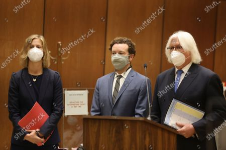 Actor Danny Masterson, center, stands with his attorneys, Thomas Mesereau, right, and Sharon Appelbaum as he is arraigned on rape charges in Los Angeles Superior Court in Los Angeles, Calif. on