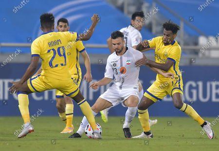 Stock Photo of Abdullah Al-Khaibari (R) of Al Nassr action against Soroosh Rafiei (L) of Sepahan FC during the 2020 AFC Champions League group D soccer match between Al Nassr of Saudi Arabia and Sepahan FC of Iran at Jassim bin Hamad Stadium Doha, Qatar on 18 September 2020.