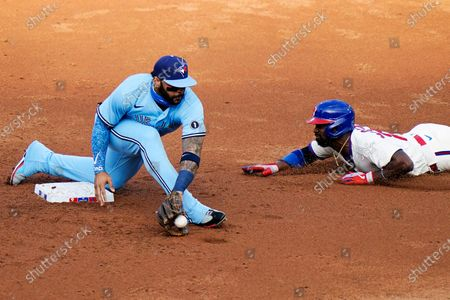 Philadelphia Phillies' Andrew McCutchen, right, steals second past Toronto Blue Jays second baseman Jonathan Villar during the third inning of the first baseball game in a doubleheader, in Philadelphia