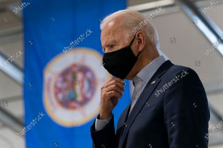 Stock Image of Democratic presidential candidate former Vice President Joe Biden pauses as he tours the Jerry Alander Carpenter Training Center in Hermantown, Minn