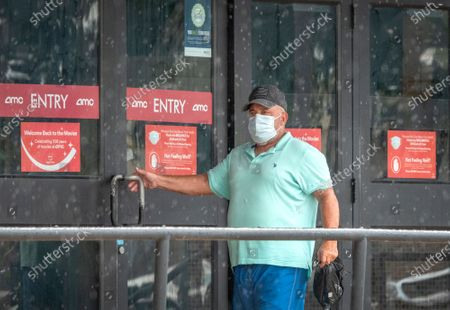 A person enters the AMC Hialeah 12 theater in Hialeah, Florida, USA, 18 September 2020. Miami's Mayor Carlos Gimenez signed amendments that will allow the movie theaters, concert houses, convention spaces, bowling alleys and other entertainment venues to operate now that the county is in phase two of the state's reopening plan.