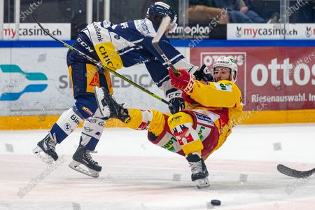 Check from Dominik Schlumpf # 18 (EV Zug) on # 21 Jason Fuchs (Biel) during the National League preparation ice hockey game between EV Zug and EHC Biel-Biennein the Bossard Arena