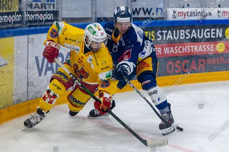 Andreas Doepfner # 91 (EV Zug) against # 21 Jason Fuchs (Biel) during the National League preparation ice hockey game between EV Zug and EHC Biel-Biennein the Bossard Arena