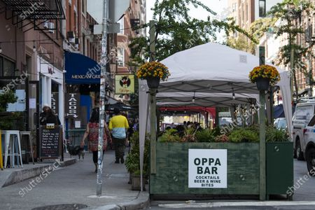 An overall view of outdoor dining locations in The West Village in Manhattan, New York. Mandatory credit: Kostas Lymperopoulos/CSM