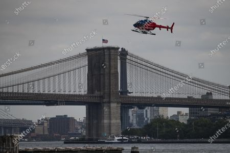 An overall view of The Brooklyn Bridge as a helicopter prepares to land on a pad in lower Manhattan in Manhattan, New York. Mandatory credit: Kostas Lymperopoulos/CSM